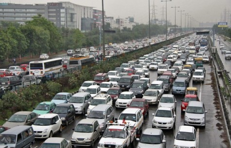 Heavy traffic moves along a busy road as it rains during a power-cut at the toll-gates at Gurgaon on the outskirts of New Delhi