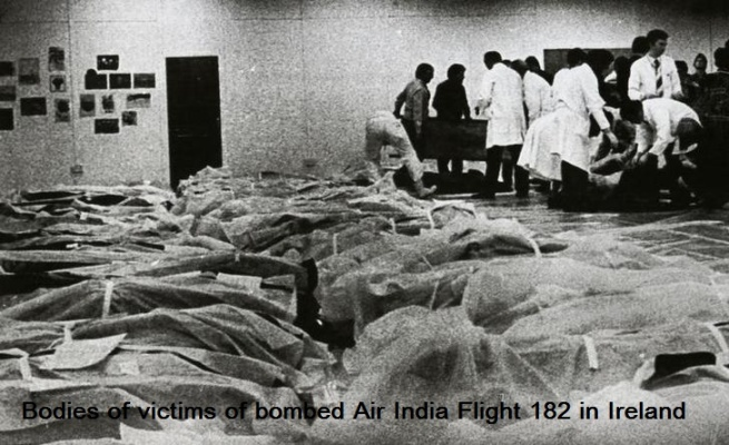 Bodies of the victims of the Air India jumbo jet which crashed off the Irish coast are wrapped in shrouds on  the floor of the Cork Regional Hospital