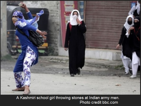 Kashmiri girl throwing stone